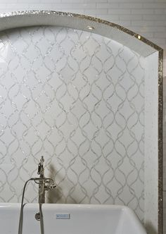 LOVE this. Love the way the frame is done with White Shell also. - Claridges Thassos Marble and White Shell lines from Artistic Tile / OTM