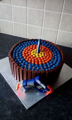 This cake is made with our clever Chocolate Fudge Cake Mix & based on a Nerf Blaster Gun theme for a 9 year old's birthday - what a target!