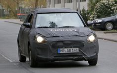 After it was leaked online, the next generation of the Maruti Suzuki Swift has been spotted testing. This is the first time that a prototype of the car has been seen in the flesh. Even though the car was heavily camouflaged, you can still see some of the design elements that were seen in the leaked images like the overall shape, new headlights and the hidden rear door handles, which are now on the upper corner of the window.