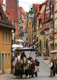 Rothenburg ob der Tauber,Bayern, Germany.  A red-walled town set up on a hill above the Tauber River. It has all the pastoral views and scenery of the Romantic Road's other castle stops yet has a strong civic pulse, too. Walt Disney was so taken by the town, in fact, that he used it as inspiration for the village in the movie Pinocchio.
