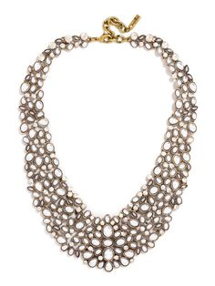 Pearls deck out this statement collar for a boldly feminine look.