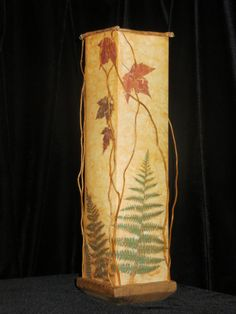Table lamp with pressed maple leaves, ferns and curly willow twigs.  www.AmbientArt.com
