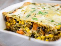 An easy enchilada casserole that is hearty and ready to feed a crowd. Filled with sweet potatoes, black beans, and corn, topped with chimichurri sauce.