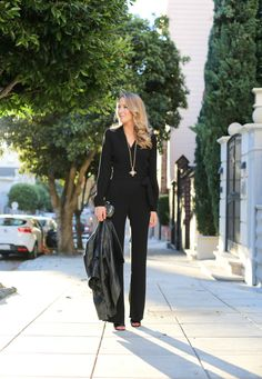 black jumpsuit with leather jacket
