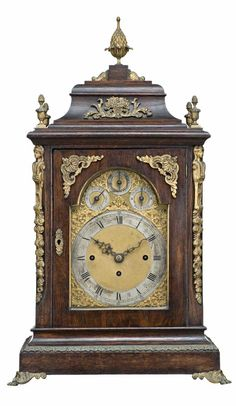 AN OAK BRACKET CLOCK, LATE VICTORIAN, CIRCA 1880  triple fusee quarter chiming on eight bells hour striking a gong, gilt metal acanthus surmounts and applied decorative motifs, scroll feet, three subsidiary dials and gilt metal dial, Roman numerals, mask head, shell scroll spandrel    41cm wide, 29cm deep, 70cm high