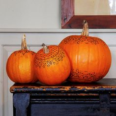 grab a doilie and stencil with a sharpie for a simple- but classy-looking pumpkin