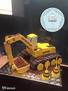 JCB Digger or Construction themed cake by Cakes by Claire.