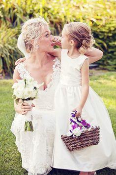 Bride & her flower girl! // Photo by Ashley B. #minneapolisweddingphotographers #weddingphotography