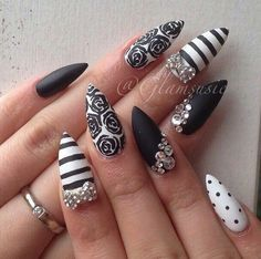 Black and white design patterns & diamond dont like stiletto nails but the nail art..yep