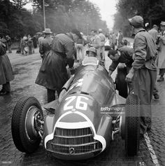 The Swiss Grand Prix; Bremgarten (Bern), May 27, 1951. Emanuel de Graffenried prepares for the start in his Alfa Romeo 159, an important guest opportunity for the talented Swiss amateur driver on his home circuit. The pavé surface at Bern was always very