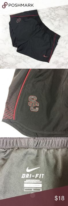 Dark Grey and Red USC Nike Dri-Fit Running Shorts Nike dri-fit shorts with USC logo. Red and grey geometric pattern on mesh. Gently used condition. Nike Shorts