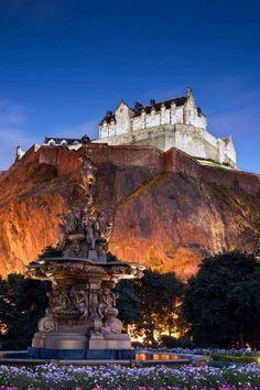 The lights of Edinburgh, Scotland with Edinburgh Castle above it.