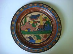 http://www.ebay.com/itm/Large-old-vintage-Mexican-Tlaquepaque-pottery-petatillo-charger-plate-16-diam-/380896203888?pt=LH_DefaultDomain_0