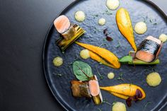 Teppanyaki style salmon and nori seaweed, burnt leeks, miso-passion fruit emulsion
