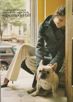Feminine masculine: cream trousers, point shoes, tweedy coat