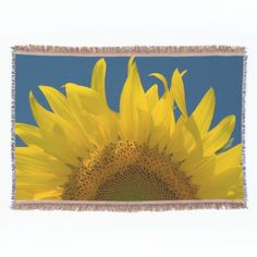 #Sunflower Rising #Throw #Blanket The pretty Sunflower Rising Throw makes a great gift idea for a flower lover, gardener or florist. This cute and custom botanical blanket features a bright floral photograph of a yellow sunflower blossom on a blue sky summer day.