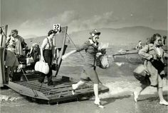 Heres something you dont see in history books. Brave women of the Red Cross hitting the beach at Normandy.
