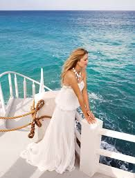 The perfect wedding gowns for your Punta Cana Beach Weddings!  These simple wedding dresses are perfect for a walk down the beach.  Find out more about Caribbean Weddings in the Dominican Republic at www.caribbean-style-weddings.com  #PuntaCana #DominicanRepublic #WeddingDress #Beach #Sun #BeachWedding #CaribbeanWedding