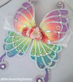 "Rainbow Butterfly plur EDC outfit inspiration festival fashion rave bra sequin pastel neon floral raver swag 289 Likes, 8 Comments - thebouncingbunny (@the.bouncing.bunny) on Instagram: "" Another rainbow butterfly fluttering off to it's new home. I love the coral and white hydrangea…"""