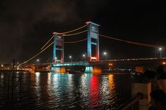 Colorful skyline: Ampera bridge in Palembang, South Sumatra, uses 30 LED lamps whose colors change automatically and are. Led Lamp, Lamps, Palembang, Hd Desktop, Mobile Wallpaper, Golden Gate Bridge, Color Change, New Look, Skyline