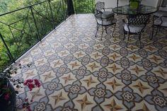An outdoor deck pops with the addition of Granada Tile's La Rochelle cement tiles