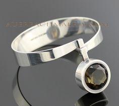 Bracelet | Elis Kauppi, designed for Kupittaan Kulta, Finland.  Sterling silver with faceted smokey quartz. 1960.
