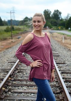 This long sleeve burgandy cold shoulder top is perfect for Fall! Pair with jeans and boots for a complete look. Shop now at Hip Chics Boutique!