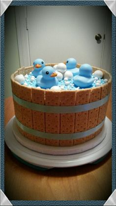Blue Baby shower cake for a boy with rubber duckies and graham crackers for barrel by Connie Cakes