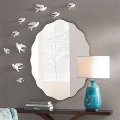 The graceful, scalloped silhouette of our oval mirror reflects beautifully on your taste for the extraordinary. Not to mention its natural light- and space-enhancing abilities that instantly make rooms feel more airy and open. Creates an eye-catching focal point above a table, mantel, or vanity Designer-quality appointments include a generous, 1-1/4 beveled edge and discreet metal frame Conveniently arrives ready to hang, vertically or horizo...