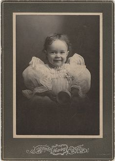 Cabinet Card of a smiling #Victorian baby. Possibly from the 1890's, judging by the puffed sleeves. #Photography