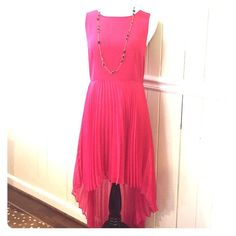Topshop pink dress Size 8 Pink high low dress. Perfect condition. Shear pleats are lined to knee. Topshop Dresses High Low