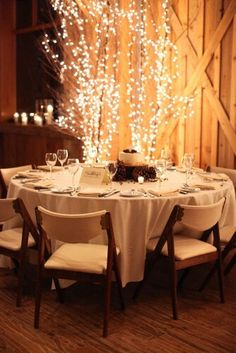 Our centerpieces are a scaled down vision of this.. lighted branches  champagne painted wine bottles in organza wine bags