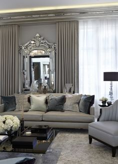 Shades of grey. Tone on tone creates very elegant, soothing living room. Love the statement mirror and the drapes same color as walls.