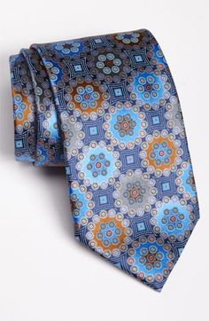 Pop some color into your ties fot a subtle, but classic look. Get Zegna ties at M Penner Houston or Bill Walker Clothier in Uptown Park