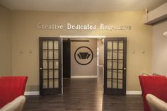 Our beautiful conference room with our mantra and logo.