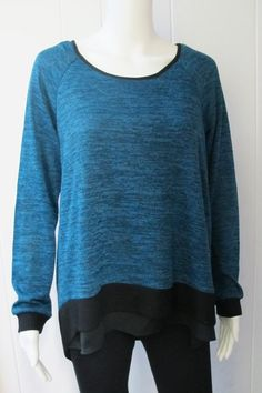 Sweater with Chiffon Trim | Pair this pretty sweater with chiffon trim with some great denim or leggings and boots for a fashion-forward look.  Scoop neck.  Long sleeve.  Peek-a-boo back. 100% Polyester.  Sizes S-XL. | Willy & Babbish Boutique | New Baltimore, MI