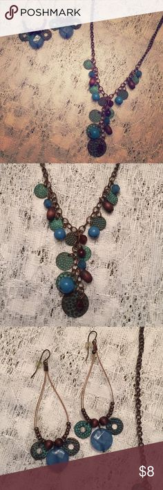 Cute brown and teal necklace and earring set. Pre- loved and in good condition. Teal metal accents and brown beads. Jewelry Necklaces