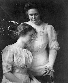 Helen Keller holding the hand of her teacher, Anne Sullivan Macy, in 1909.   Old Photo Archive