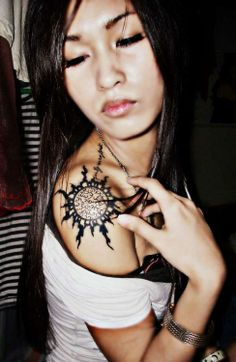 sun tattoo   i would get that on my back though