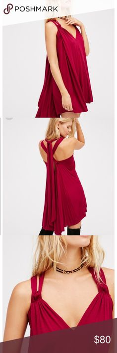 💗 Free People Red Dress American made swingy dress featuring a V-neckline with crisscross detail at the front and back. Adjustable straps tie at the back of the neck for an easy, effortless fit. High-low hem and drapey silhouette. Perfect for the holidays, daily wear, or any occasion! Free People Dresses High Low