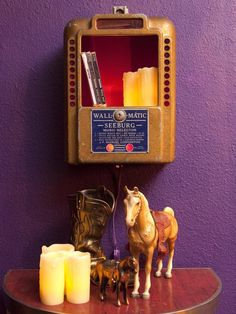 a vintage tabletop jukebox has come back to life as a wall shelf for the RETRO ROCkabilly LIVIng room for JOHN Evans! from our show on HGTV!  {junk gypsy co, http://gypsyville.com/ }