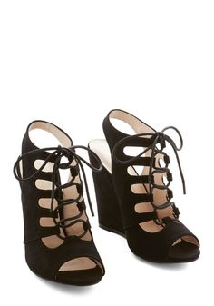 That's Haute Bootie. You sure feel hot to trot when youre strolling in these chic black wedges! #black #modcloth