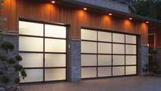 With recessed lights overhead, these translucent garage doors have a glowing effect that's quite inviting.