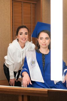 Queen Rania of Jordan (L), during the graduation ceremony of Princess Salma (R) from the International Academy on May 22, 2018, at Amman, Jordan.