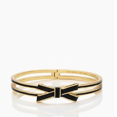 ✨NWT✨ Kate Spade Bow Hinge Bangle Black NWT! Authentic Kate Spade black bow hinge bangle. 12 karat gold plated metal with enamel fill. Dust bag included. ***No Trades or PayPal*** kate spade Jewelry Bracelets