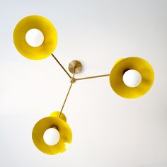 Mid Century Modern chandelier in yellow and brass with Cone shades. Perfect pop of color for eclectic interior design. Bathroom Chandelier, Sputnik Chandelier, Chandelier Lighting, Chandeliers, Mid Century Modern Chandelier, Modern Interior, Interior Design, Plates On Wall, Modern Lighting