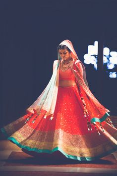 Real Indian Wedding - Tanya and Paritosh | WedMeGood | Twirling Bride in an Orange and Aquamarine Lehenga with Orange Dupatta and Latkans #wedmegood #lehenga #indianbride #indianwedding #bridal #twirling