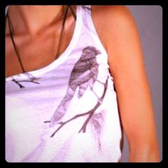 "Host PickHandmade Printed Tee  3x Host Pick  Handmade sleeveless printed tee. Bird on a twig design. * Never Worn *. Quality is excellent. I love this tee and would totally keep it if it wasn't too small for me . I'm a 34"" bust and it's too much of a squeeze. Plus too tight around the arm holes. My ""arm hole girth"" (I had to look that up) is 17"" when not too loose or too tight. So you would need to be smaller than that. I think this would work best on a S or XS. Tops"