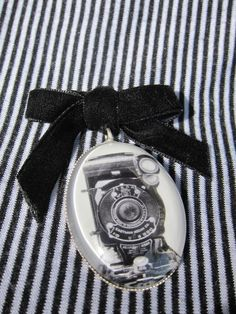 Camera's Eye - Vintage velvet bow art brooch featuring black and white photograph of a Kodak Camera under glass cab