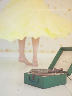 Spinning in yellow dress to the music from a phonograph. Amazing.!